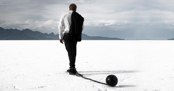 disappointed-businessman-dragging-ball-and-chain_573x300